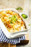 Pasta bake with tomatoes, cheese and fresh parsley Stock Photo