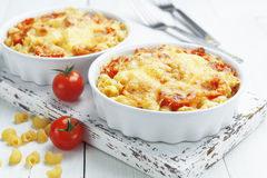 Pasta baked with tomato and cheese Stock Photos