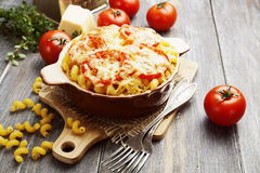 Pasta baked with tomato and cheese. In a ceramic pot Stock Images