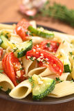 Pasta with Baked Zucchini and Tomato Stock Photos