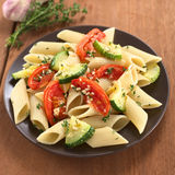 Pasta with Baked Zucchini and Tomato Stock Photography