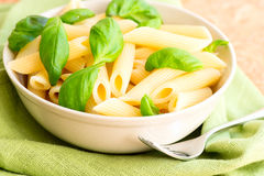 Pasta and basil in a bowl Royalty Free Stock Photos