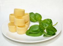 Pasta and basil leaves Royalty Free Stock Image