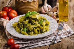 Pasta with basil pesto Stock Photos
