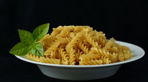 Pasta and basil Royalty Free Stock Photos