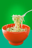 Pasta with basil in a red  bowl Stock Photo