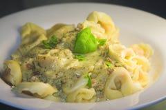 Pasta with basil sauce Stock Photo