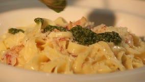 Pasta with basil sause stock footage