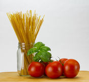 Pasta basil and tomatoes Stock Photos