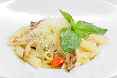 Pasta with basil and tomatoes Royalty Free Stock Photography