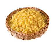 Pasta in basket on isolated background Stock Photo