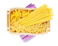 Pasta in basket Stock Images