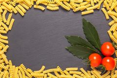 Pasta with bay leaf and tomatoes royalty free stock photo