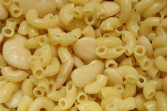 Pasta and beans. Macaroni pasta and butterbeans cooking in pan Stock Images
