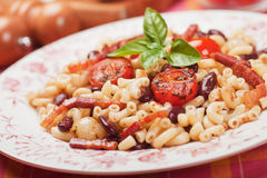 Pasta with beans, bacon and cherry tomato Stock Photography