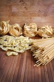 Pasta. Beautiful shot of different types of pasta on wooden background Stock Image