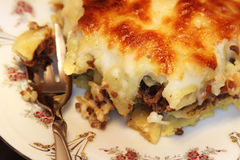 Pasta with bechamel sauce or casserole. Baked pasta with meat, bechamel sauce and cheese on plate with fork Stock Image
