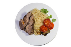 Pasta with beef steak and vegetables Royalty Free Stock Photos