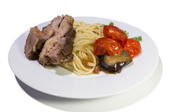 Pasta with beef steak and vegetables Stock Images