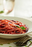 Pasta with beetroot Stock Photo