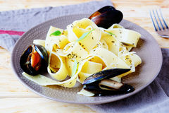 Pasta with big mussels Stock Image