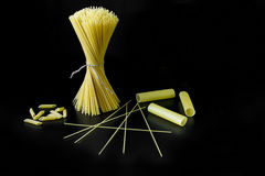 Pasta on a black background. Closeup stock photography