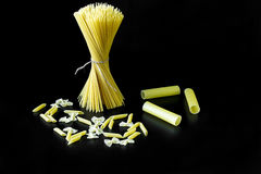 Pasta on a black background. Closeup royalty free stock photo