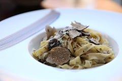Pasta with black truffles , Italian food. Pasta with black truffles on a plate , Italian food stock photo