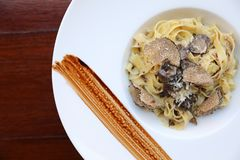 Pasta with black truffles , Italian food. Pasta with black truffles on a plate stock image
