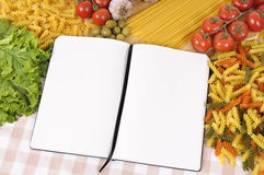 Pasta with blank recipe book and chopping board Stock Photos