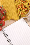 Italian spaghetti and Pasta with blank recipe book, copy space, vertical Royalty Free Stock Images