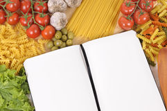 Making Italian pasta food with blank recipe book, cookbook, copy space. Selection of Italian spaghetti and pasta with blank recipe book or cookbook. Space for Stock Image