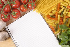 Selection of Italian pasta ingredients with blank recipe book, copy space Royalty Free Stock Image