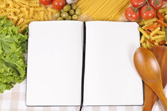 Pasta with blank recipe book and chopping board Royalty Free Stock Photos