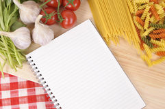 Pasta with blank recipe book and red check tablecloth Royalty Free Stock Photography