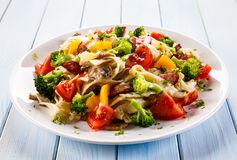 Pasta. With boiled colorful vegetables and mushrooms Stock Photo