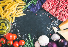 Pasta Bolognese ingredients: penne, minced meat, tomatoes, basil Royalty Free Stock Photography