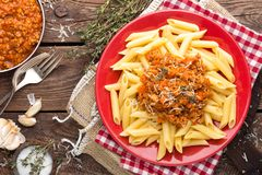 Pasta bolognese. Pasta served with a sauce of ground beef meat, tomato, onion, carrot and thyme Royalty Free Stock Photography