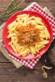 Pasta bolognese. Pasta served with a sauce of ground beef meat, tomato, onion, carrot and thyme Royalty Free Stock Images