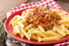 Pasta bolognese. Pasta served with a sauce of ground beef meat, tomato, onion, carrot and thyme Stock Photography