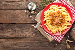 Pasta bolognese. Pasta served with a sauce of ground beef meat, tomato, onion, carrot and thyme Royalty Free Stock Image