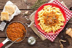 Pasta bolognese. Pasta served with a sauce of ground beef meat, tomato, onion, carrot and thyme Royalty Free Stock Photo