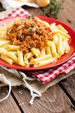 Pasta bolognese. Pasta served with a sauce of ground beef meat, tomato, onion, carrot and thyme Stock Photos
