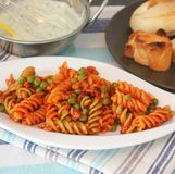 Pasta bolognese with peas Royalty Free Stock Images