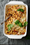 Pasta Bolognese in white baking dish on a linen napkin. Top view Royalty Free Stock Images