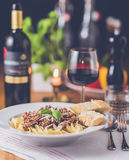 Pasta Bolognese and wine Royalty Free Stock Photos