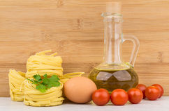 Pasta, bottle of oil, egg and tomatoes cherry Royalty Free Stock Images