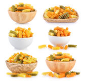 Pasta in bowl and basket Royalty Free Stock Photos