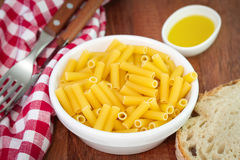 Pasta in bowl with bread Stock Photography