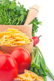 Pasta in bowl and vegetable Stock Photo